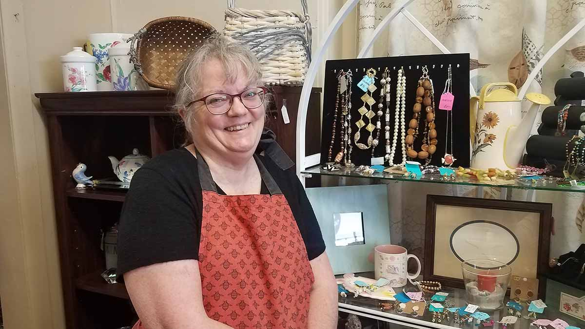 "Melissa Jones is a booth vendor at Mrs. Pinkadot in Norfolk. A first grade teacher, Jones says she makes extra money from her booth at the store. As for coronavirus, she says she has, ""a healthy respect for it."""