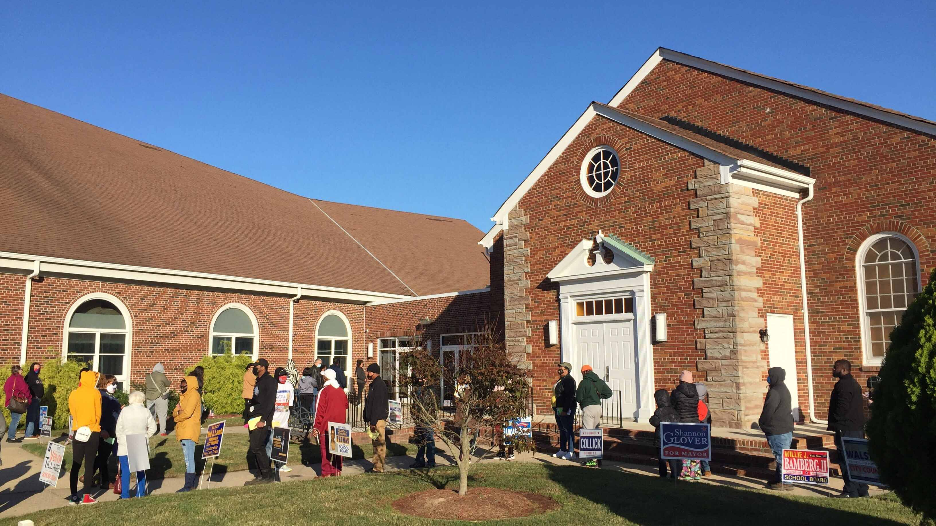 Photo by Jonah Grinkewitz, WHRO. Portsmouth voters lined up on a crisp Election Day 2020 at Grove Baptist Church to cast their ballots for the presidency among other important local races.