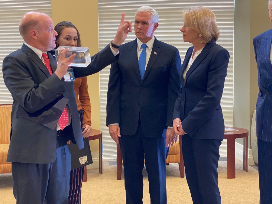 Dr. Allen Thornton, a radiation oncologist at the Hampton University Proton Institute, shows Vice President Mike Pence and Secretary of Education Betsy DeVos how proton rays can treat cancer.